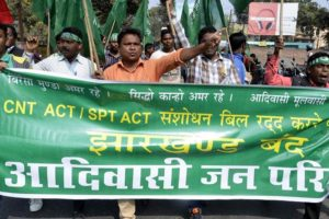 Activists from Adivasi Jan Parishad (AJP) stage a protest during Jharkhand Bandh called by all opposition parties to protest against of amendment in the Chotanagpur Tennacy and Santhal Paragana Tennacy (SPT) acts (Land acquisition bill) 2016 in Ranchi, Jharkhand on Friday. Credit: PTI/Files