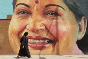 A woman walks past a portrait of J. Jayalalithaa, chief minister of Tamil Nadu, in Chennai March 13, 2012. Credit: Reuters/ Files