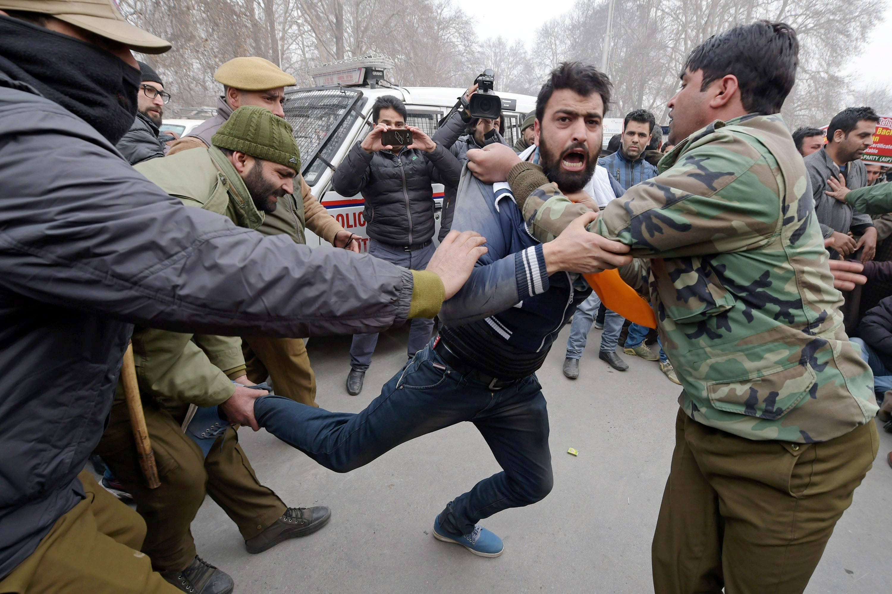 Police detain supporters of the Awami Itihaad Party led by Independent MLA Abdul Rashid Sheikh, during a protest march against issuing domicile certificates to West Pakistani refugees, in Srinagar on Thursday. Credit: PTI/S. Irfan