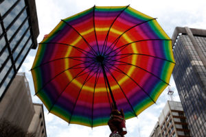 A transvestite holds up a rainbow coloured umbrella during the 15th Gay Pride Parade in Avenida Paulista in Sao Paulo June 26, 2011.