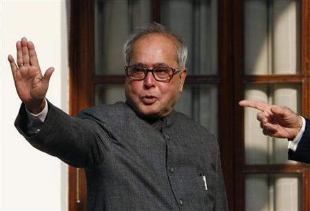 Pranab Mukherjee waves to the media in New Delhi November 27, 2006. REUTERS/Adnan Abidi/Files