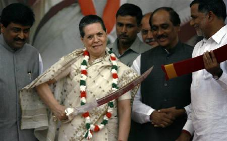 File photo of Congress president Sonia Gandhi wielding a sword at a rally in Maharashtra. Credit: Reuters
