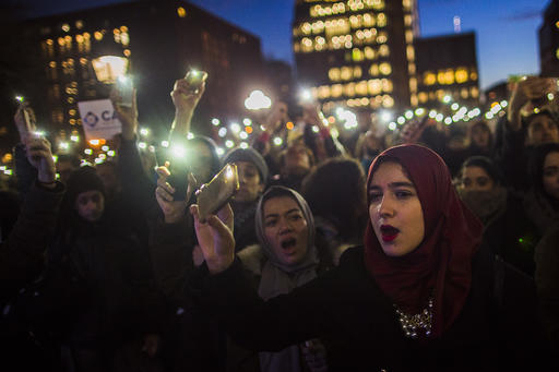 Muslim women shout slogans during a rally against President Donald Trump's order cracking down on immigrants living in the U.S. at Washington Square Park in New York, Wednesday, Jan. 25, 2017. (AP Photo/Andres Kudacki)