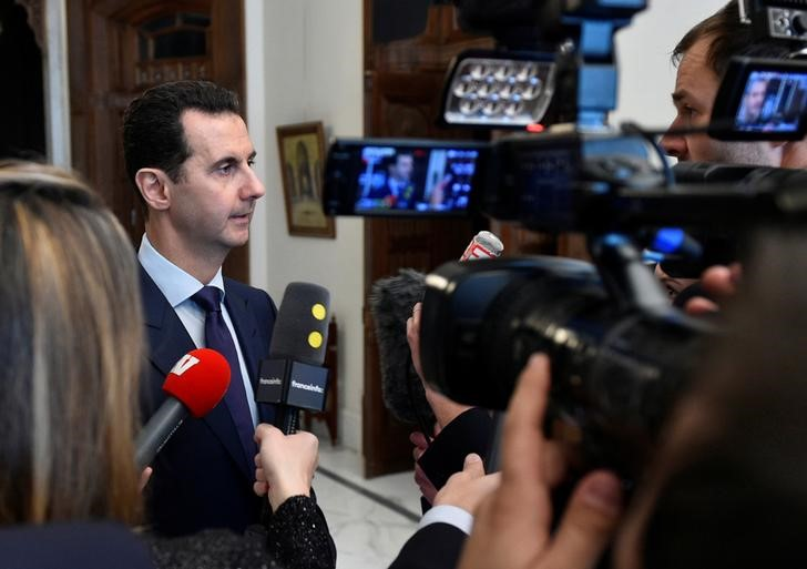 Syria's President Bashar al-Assad speaks to French journalists in Damascus, Syria, in this handout picture provided by SANA on January 9, 2017. Credit:  SANA/Handout via Reuters