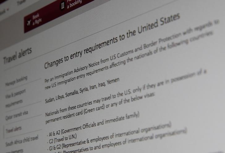 A picture of the travel advisory page of Qatar Airways advising passengers bound for the United States from seven newly banned majority Muslim countries that they need to have either a US green card or diplomatic visa, January 28, 2017 in London, Britain. Picture taken January 28, 2017. Credit: Reuters/Russell Boyce
