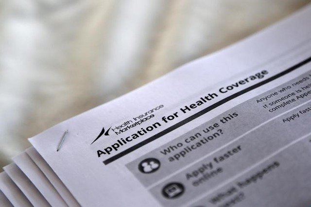 "The federal government forms for applying for health coverage are seen at a rally held by supporters of the Affordable Care Act, widely referred to as ""Obamacare"", outside the Jackson-Hinds Comprehensive Health Center in Jackson, Mississippi, U.S. on October 4, 2013. Credit: Reuters/Jonathan Bachman/File Photo"