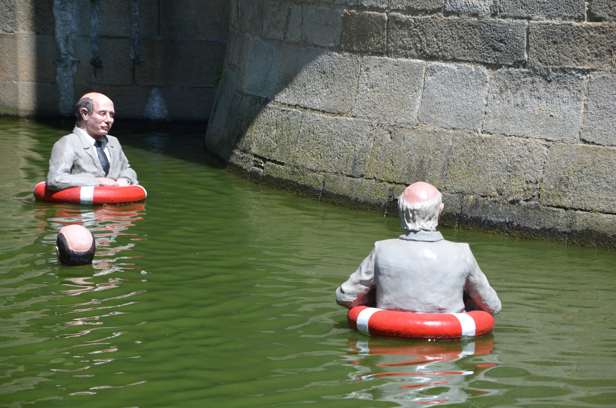 An art exhibit by sculptor Isaac Cordal in Nantes, France, in 2013 shows businessment with floats going about business after global sea levels have risen due to climate change. Credit: objectifnantes/Flickr, CC BY 2.0