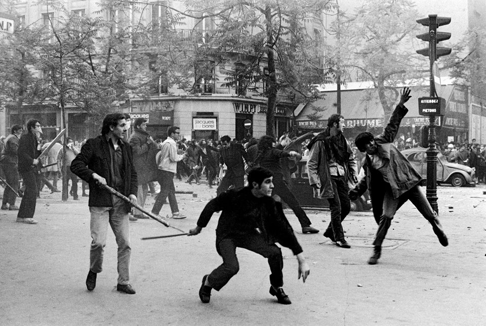 Students hurtling projectiles against the police. Boulevard Saint Germain, 6th arrondissement, Paris, France. May 6th, 1968. Credit: Magnum Photos/Facebook
