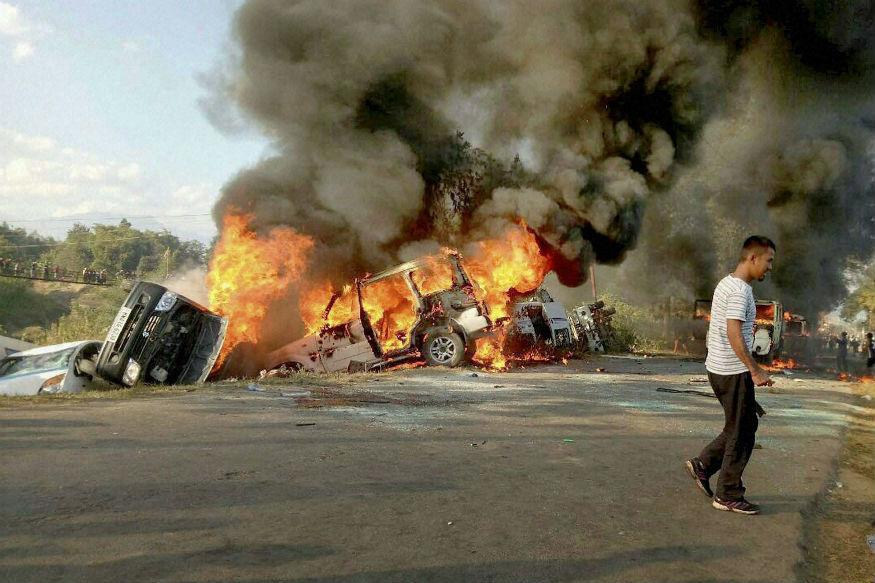 Several vehicles were set on fire in Imphal East district on December 18 to protest against UNC's economic blockade. Credit: PTI