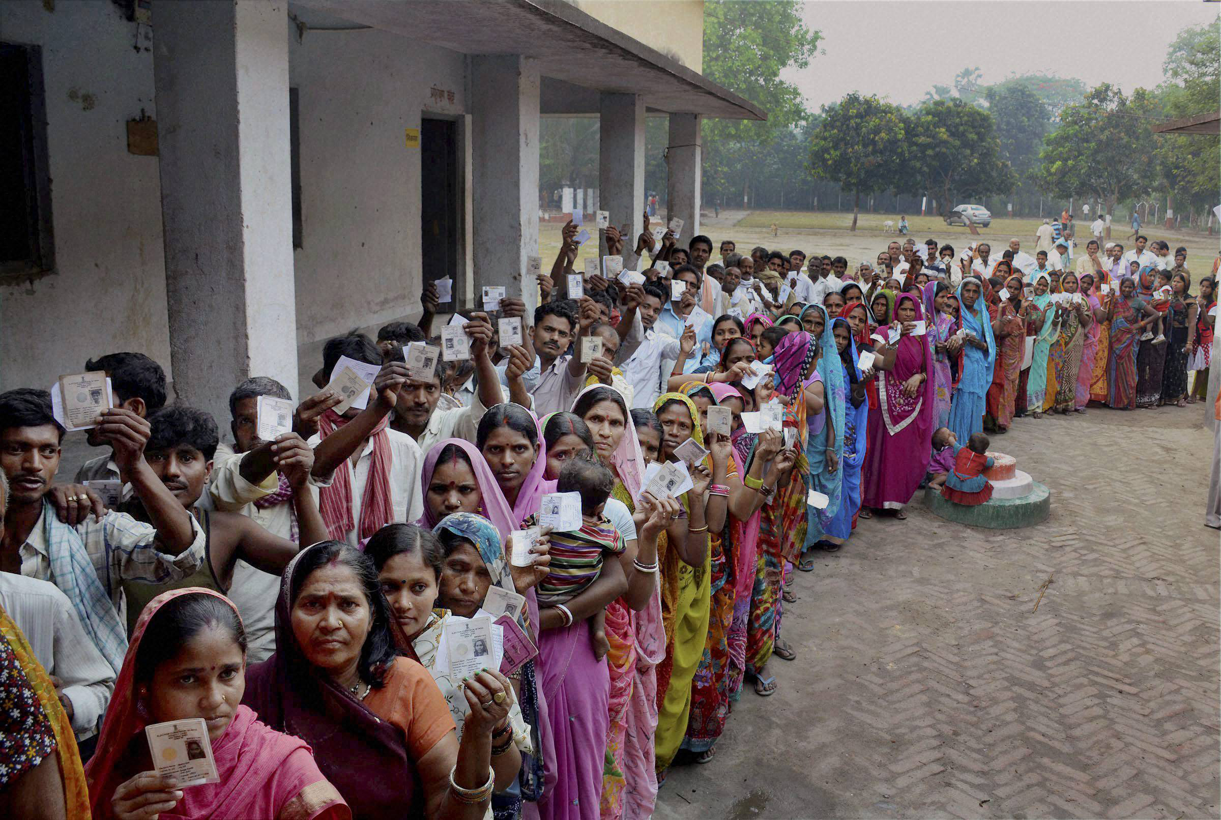 Voters queue to exercise their franchise. Credit: PTI