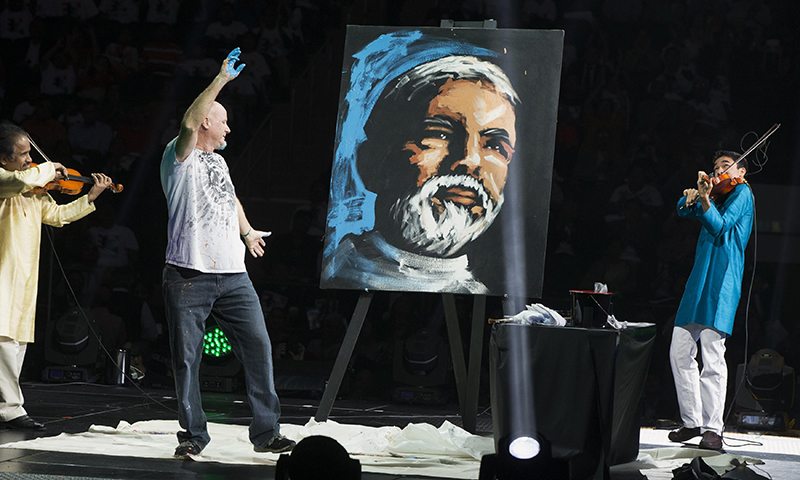 A painter reacts as he creates a portrait of India's Prime Minister Narendra Modi before Modi was scheduled to speak at Madison Square Garden in New York, during his visit to the US, September 28, 2014. Credit: Reuters/Lucas Jackson