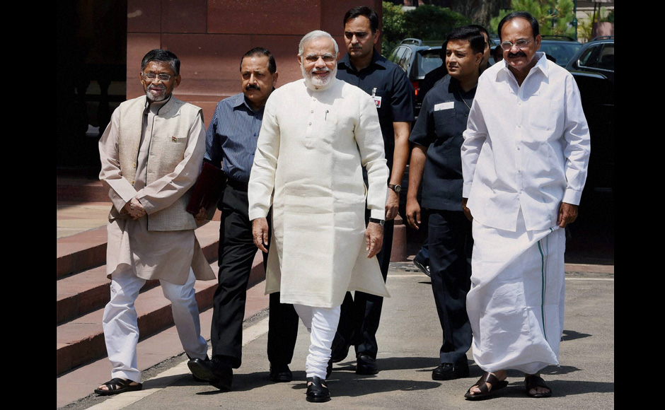 Minister of state for finance Santosh Singh with Prime Minister Narendra Modi and union minister Venkaiah Naidu