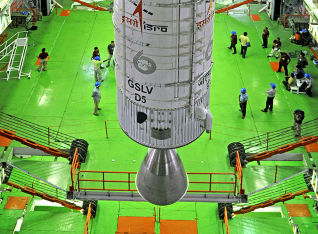 Engineers around the GSLV D5 ahead of its launch, in the vehicle assembly building, Sriharikota. Credit: ISRO