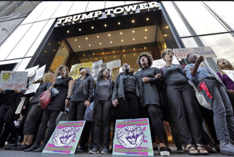 Women protest outside Trump Tower. Credit: Twitter