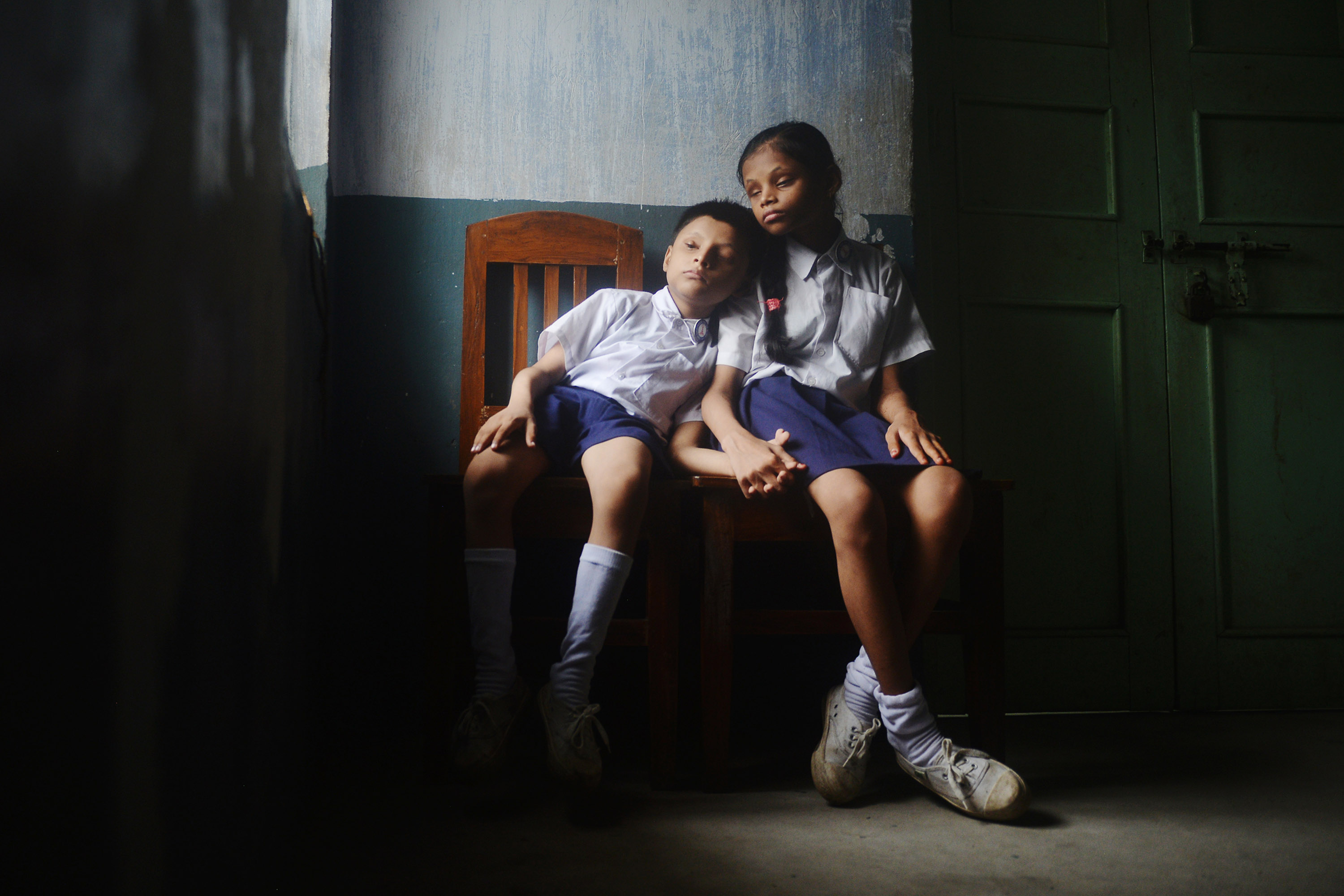 Siblings wait for their parents to take them home from school. Students from out of town stay in the hostels, which are well-equipped for hosting the visually impaired. Credit: Sutirtha Chatterjee