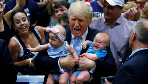 Donald Trump holds babies at a rally in Colorado Springs, Colorado on July 29, 2016. He is not believed to have booted either from that rally. Credit: Reuters