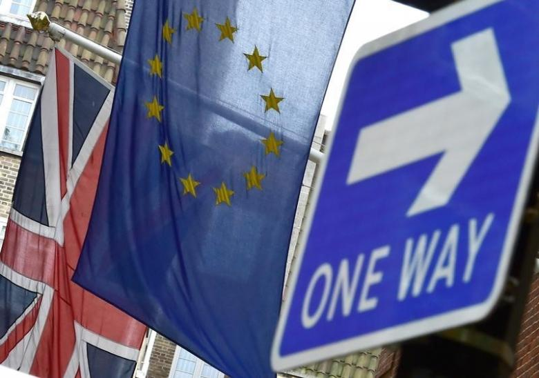 The British Union flag and European Union flag are seen hanging outside Europe House in central London June 9, 2015. Credit: Toby Melville/Reuters/Files