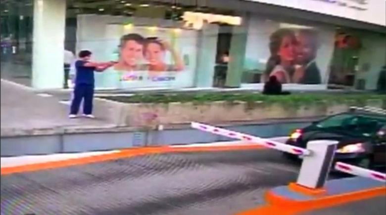 A man shoots at a US consular official in his car in Guadalajara, Mexico, in this still image taken from January 6, 2017 security video footage released by the US embassy in Mexico.      Credit: Unidentified source distributed by US Embassy in Mexico/Handout via Reuters TV