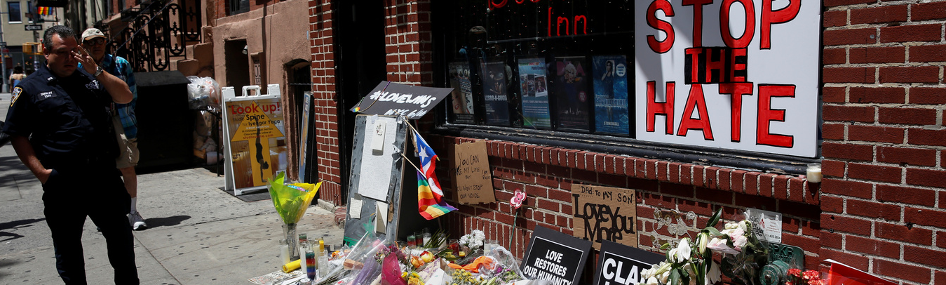 A NYPD officer wipes his eye at a memorial outside The Stonewall Inn remembering the victims of the Orlando massacre in New York, US, June 13, 2016. Credit: Reuters/Shannon Stapleton