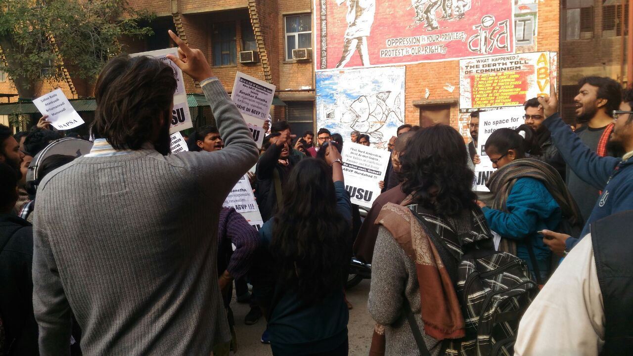 Students in JNU protest outside a faculty building. Credit: Twitter