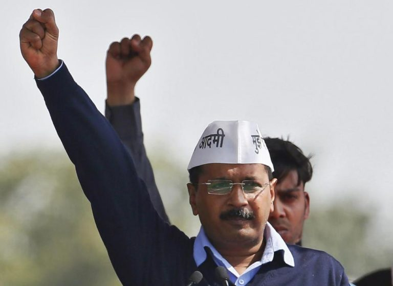 Arvind Kejriwal, chief of Aam Aadmi Party (AAP), shouts slogans after taking the oath as the new chief minister of Delhi during a swearing-in ceremony at Ramlila ground in New Delhi February 14, 2015. Credit: Anindito Mukherjee/Files