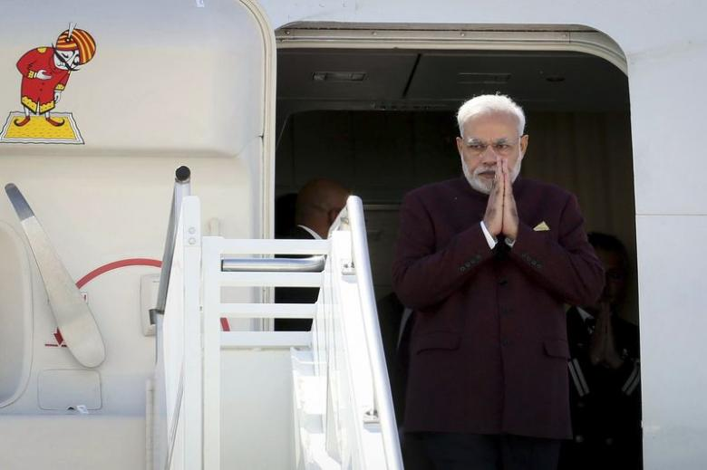 Prime Minster Narendra Modi walks out of the airplane as he arrives at JFK airport in New York September 26, 2014, a day before his appearance at the United Nations General Assembly. REUTERS/Mohammed Jaffer-SnapsIndia