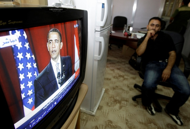 An Iraqi man in Baghdad watches US President Barack Obama's speech in  June 2009 in Cairo. Credit: Reuters