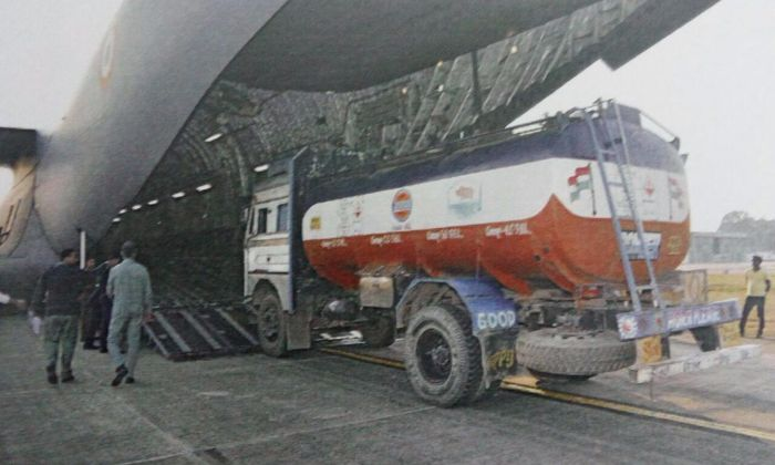 An oil taker being loaded into an IAF aircraft in Borjhar airport in Guwahati for Imphal. Credit: PTI