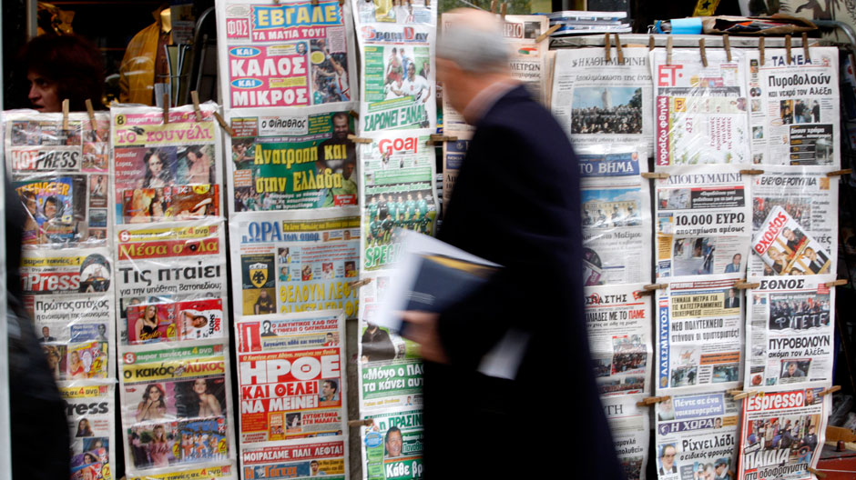 Man walking in front of a newspaper vendor. Representative image. Credit: Reuters