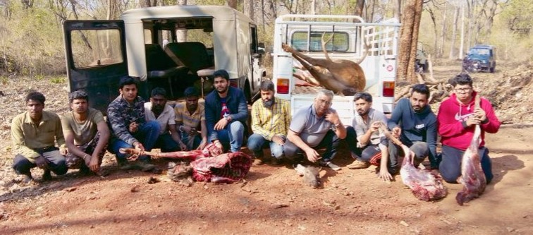Poachers with seized Sambar carcass and vehicles from New Year's arrest. Credit: WCS-India via Mongabay