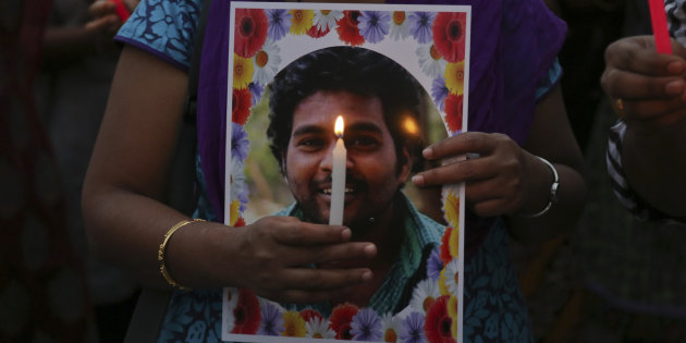 Activist of a Dalit organisation participate in a candle light vigil holding photographs of Rohith Vemula in Hyderabad, India, Wednesday, January 20, 2016. Credit: Associated Press