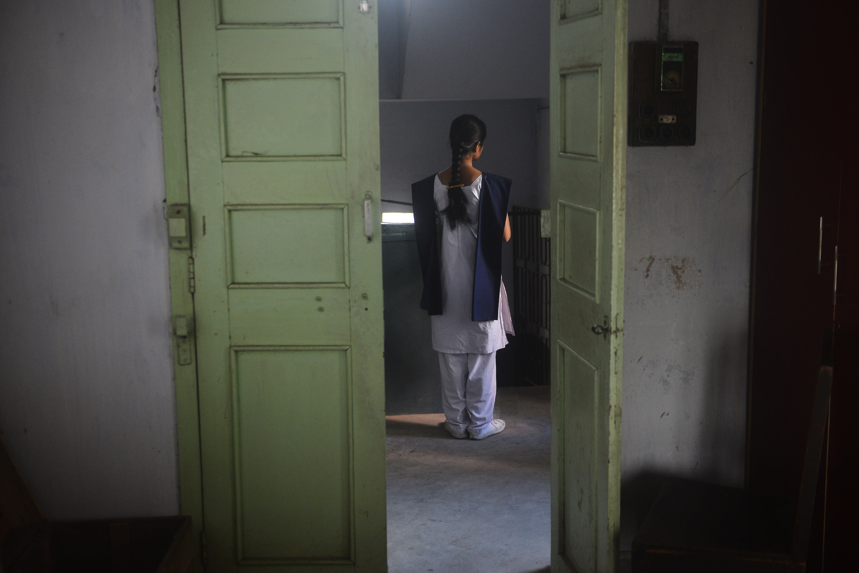 A student waits for her friends to join her for a class. Credit: Sutirtha Chatterjee