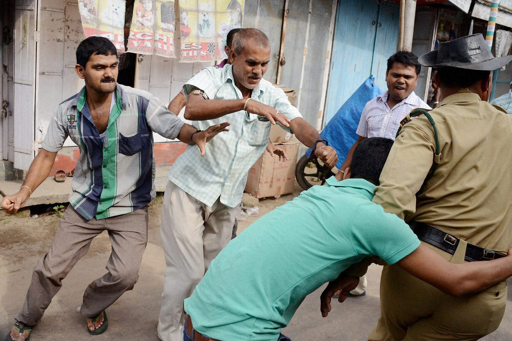 Police intervenes during a clash between Indigenous People's Front of Tripura (IPFT) members and local Bengali people following an IPFT rally in Agartala. Credit: PTI