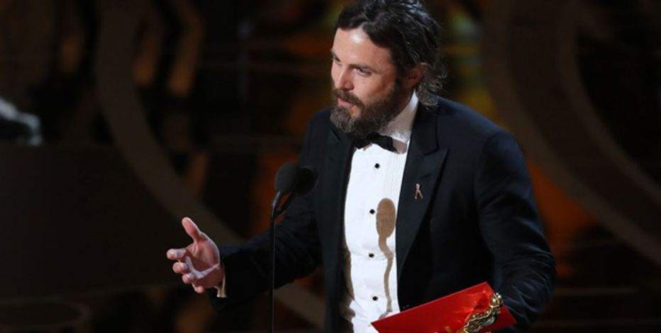 Casey Affleck accepting his Oscar for best actor. Credit: Reuters