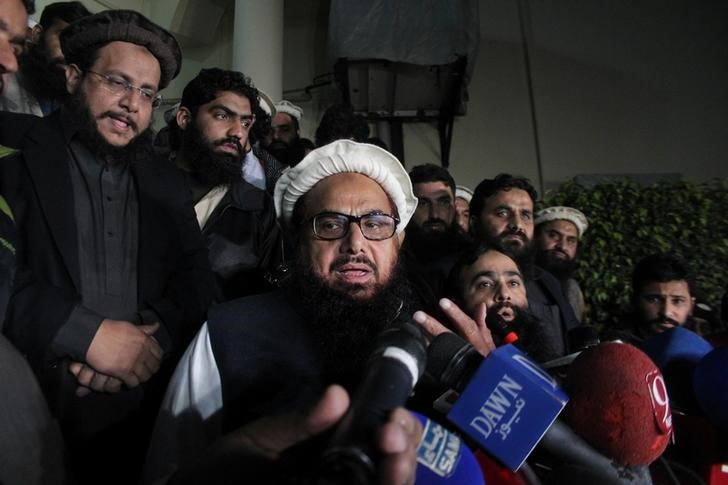 Hafiz Saeed, chief of the Jamat-ud-Dawa, speaks with the media before being put under house arrest in Lahore, Pakistan. Credit: Reuters