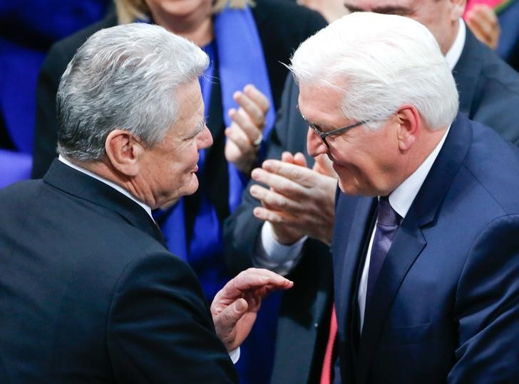 German president-elect, Frank-Walter Steinmeier receives congratulations from predecessor Joachim Gauck after the first round of voting of the German presidential election at the Reichstag in Berlin, February 12, 2017.      Credit: Reuters/Hannibal Hanschke