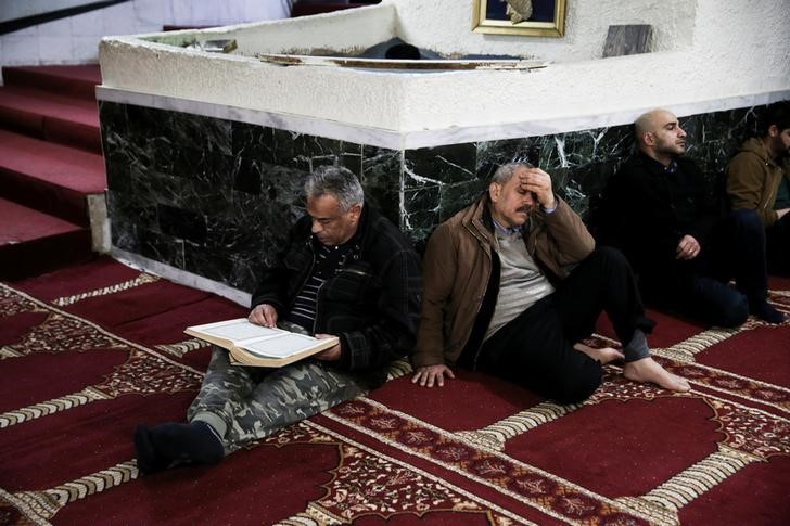 Muslims living in Greece attend Friday prayers at the Masjid Al-Salam makeshift mosque in Athens, Greece, February 3, 2017. Credit: Reuters/Alkis Konstantinidis