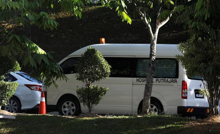 A hospital ambulance believed to be carrying the body of Kim Jong Nam leaves the morgue at Putrajaya hospital in Malaysia on February 15, 2017. Credit: Reuters/Edgar Su