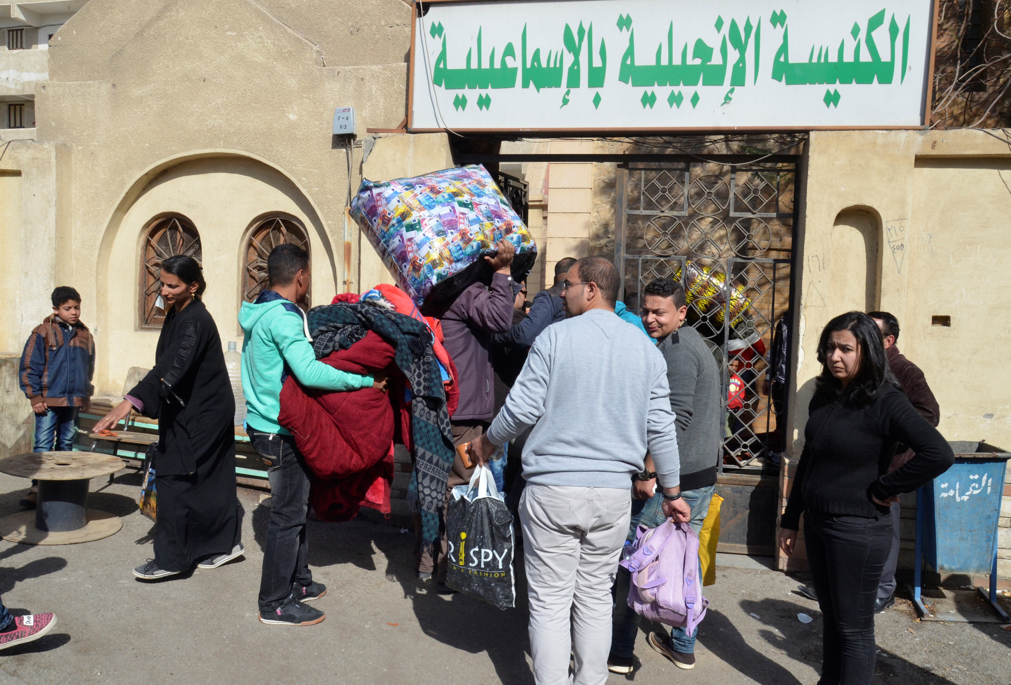 Christian families who left from Al-Arish in the North Sinai Governorate after the escalation of a campaign targeting Christians by Islamic State militants last week, arrive at the Evangelical Church in Ismailia, Egypt February 24, 2017. Credit: Ahmed Aboulenein/Reuters