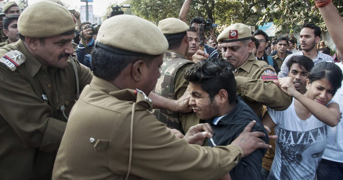 Police attempting to control protestors at Ramjas College. Credit: PTI