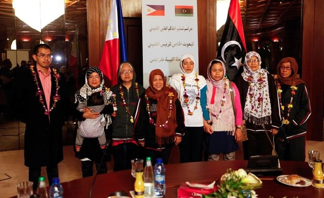 Filipino nurses, who were freed from Islamic State militants by Libyan forces in Sirte, pose for a group photo during a handover ceremony in the presence of a Filipino envoy in Tripoli, Libya, February 27, 2017.   Credit: Ismail Zitouny/Reuters