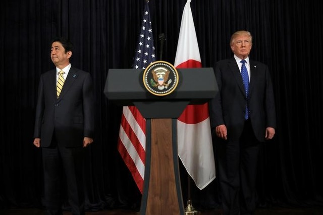 US President Donald Trump and Japanese Prime Minister Shinzo Abe leave after delivering remarks on North Korea at Mar-a-Lago club in Palm Beach, Florida US, February 11, 2017. Credit: Reuters/Carlos Barria