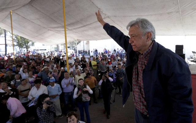 FILE PHOTO - Andres Manuel Lopez Obrador, leader of the National Regeneration Movement (MORENA) party, waves after giving a speech to supporters in Tlapanoloya, Mexico, January 25, 2017. REUTERS/Henry Romero/File Photo