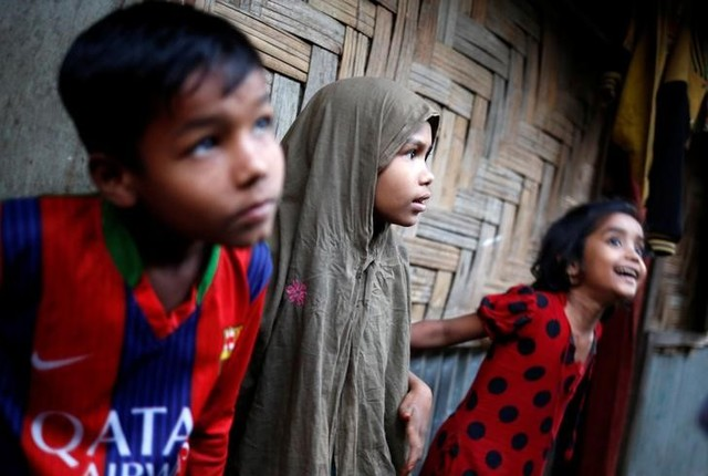 Rohingya refugee children look on at Leda Unregistered Refugee Camp in Teknaf, Bangladesh, February 15, 2017. Credit: Reuters/Mohammad Ponir Hossain