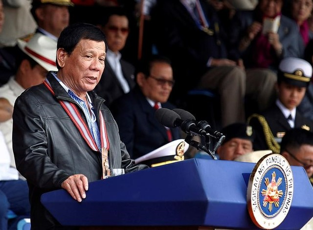 Philippine President Rodrigo Duterte delivers a speech during the Philippine Military Academy alumni homecoming in Fort Del Pilar, Baguio city, north of Manila, Philippines, February 18, 2017. Credit: Reuters/Harley Palangchao