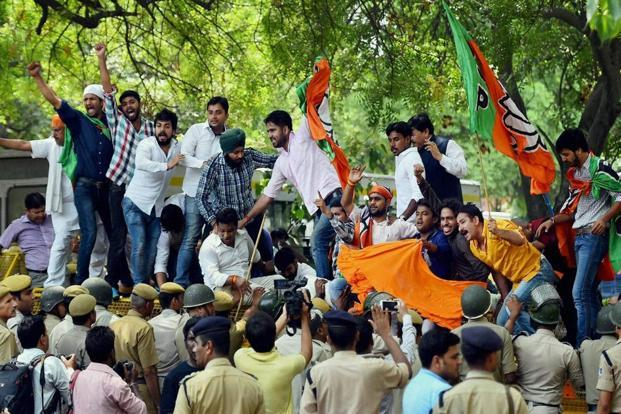 BJP workers protesting killings of their supporters in Kerala outside the CPI(M) office in New Delhi in May 2016. Credit: PTI