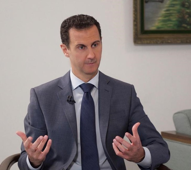 Syria's President Bashar al-Assad speaks during an interview with al-Watan newspaper in Damascus, Syria, in this handout picture provided by SANA on December 8, 2016. SANA/Handout via REUTERS/Files