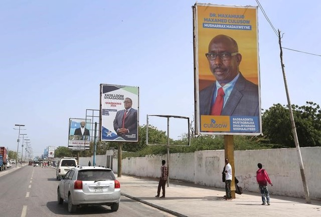 Motorists drive along a street with the campaign billboards of Somalia's Presidential candidates in Somalia's capital Mogadishu, February 6, 2017. REUTERS/Feisal Omar