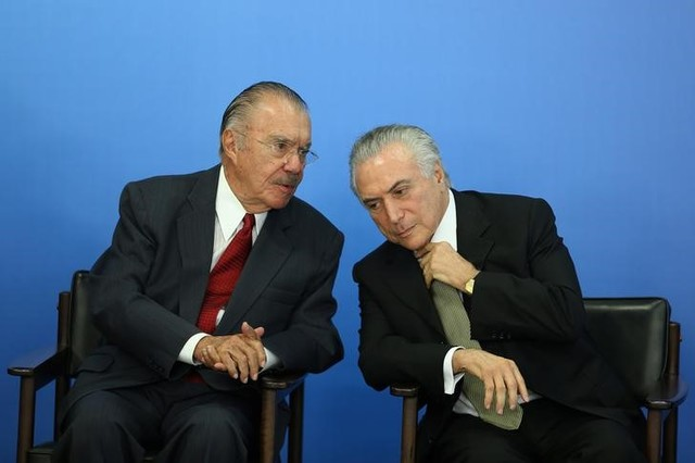 Brazil's interim President Michel Temer (R) speaks with Brazilian politician Jose Sarney during a ceremony for inauguration of the new Minister of Culture, Marcelo Calero, at the Planalto Palace in Brasilia, Brazil, May 24, 2016. REUTERS/Adriano Machado