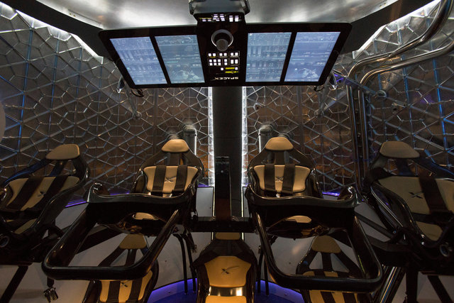 The cabin of the Dragon V2 spacecraft is pictured after it was unveiled in Hawthorne, California May 29, 2014. Credit: Reuters